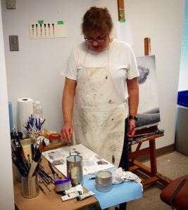 Toni Hamel painting in the Art Lab